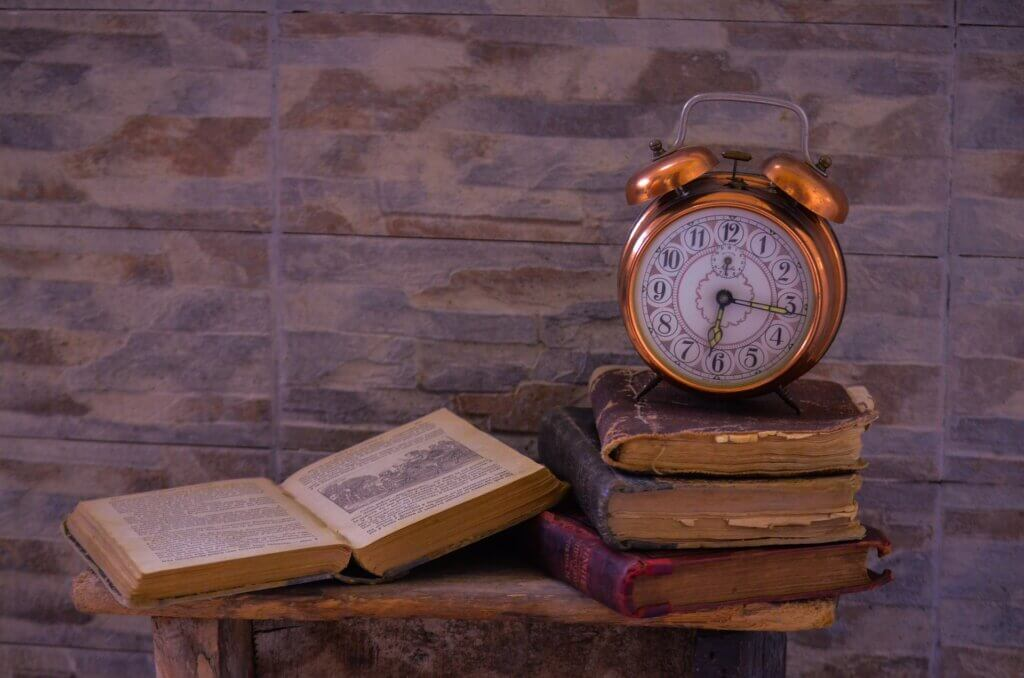 vintage books and and old clock